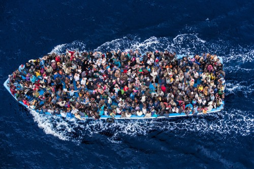 Boat Migrants Risk Everything for a New Life in Europe:  African asylum seekers rescued off boats and taken aboard an Italy navy ship, June 8, 2014.